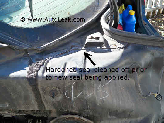 Removing bad seam sealer from Saturn car that has Trunk Leak